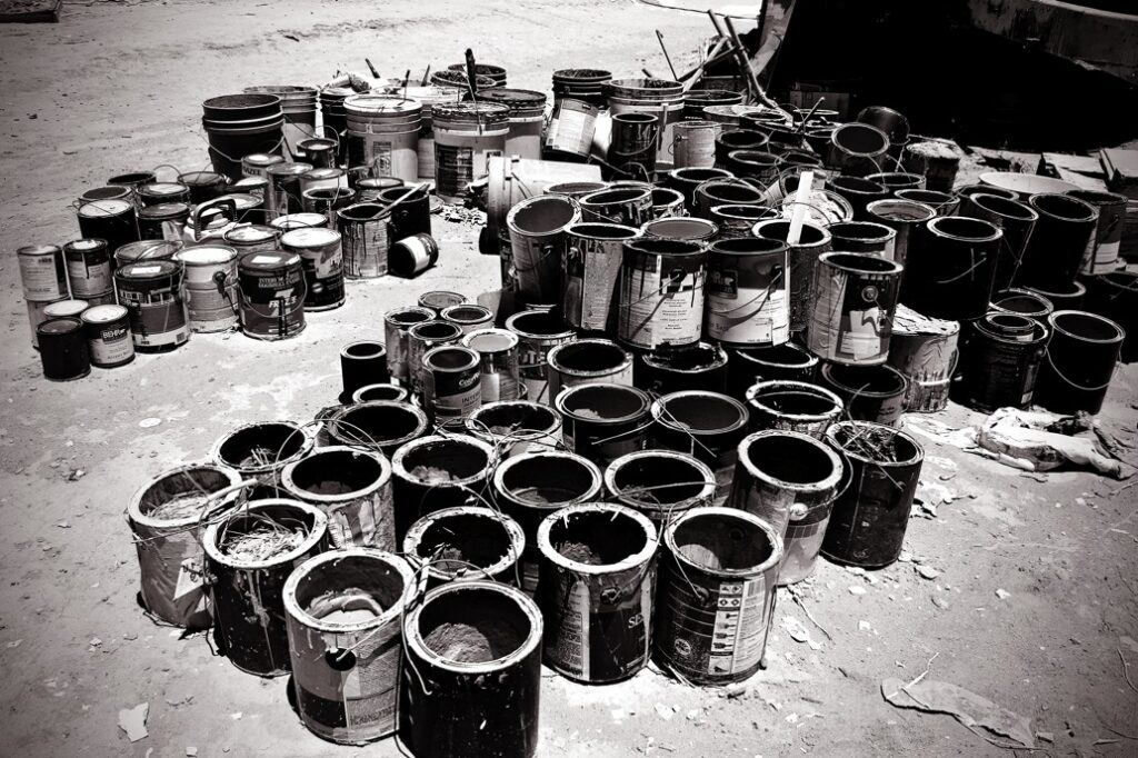 Black and white paint cans