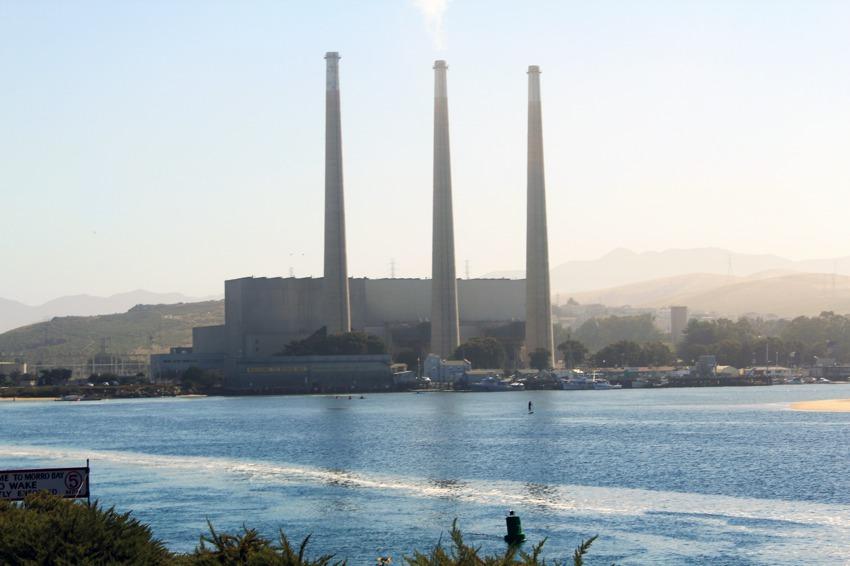 Paddleboarder and smoke stacks morro bay