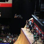 Sean White doing a grab X games Skatboard vert