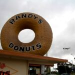 Randys donuts with plane flying overhead