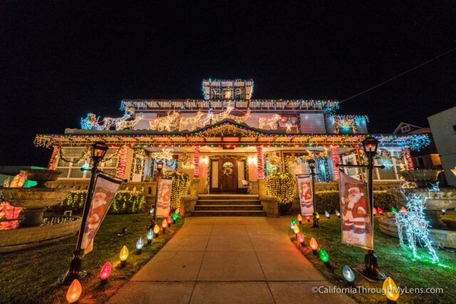 this 100 year old house is a real estate office during the day and a christmas masterpiece at night the house is extravagant with its lighting display