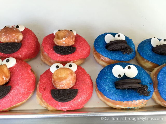 Image result for cookie monster eating donut